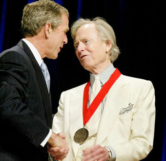Wolfe reciving honors from then-President George W. Bush