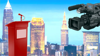 image composed by Thursday Review of Cleveland skyline with video camera and podium