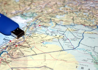 flash drive on a map of Syria and Iraq.