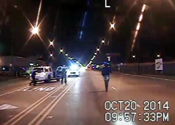 Still frame from dash camera in Chicago police car one second before Laquan McDonald was shot by police